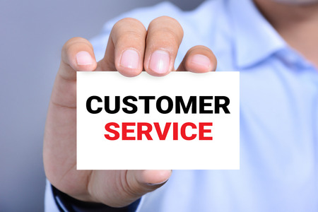 customer service: CUSTOMER SERVICE message on the card held by a man hand