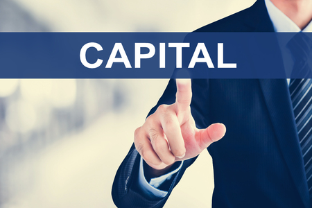 business funds: Businessman hand touching CAPITAL word on virtual screen
