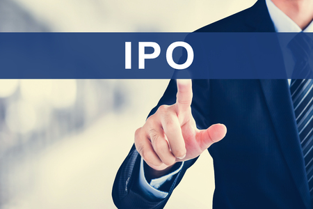 Businessman hand touching IPO (or Initial Public Offering ) tab on virtual screen