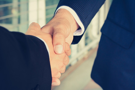 Handshake of businessmen - greeting, dealing, mergers and acquisition concept