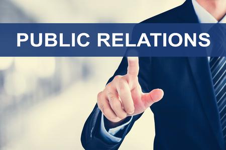 relaciones publicas: Mano de empresario tocar pestaña RELACIONES PÚBLICAS en la pantalla virtual