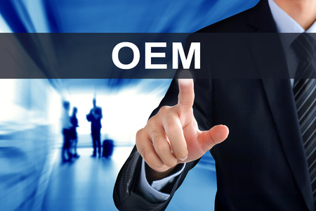 aftermarket: Businessman hand touching OEM (or Original Equipment Manufacturer) text on virtual screen Stock Photo