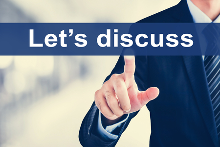 lets: Businessman hand touching Lets discuss message on virtual screen Stock Photo