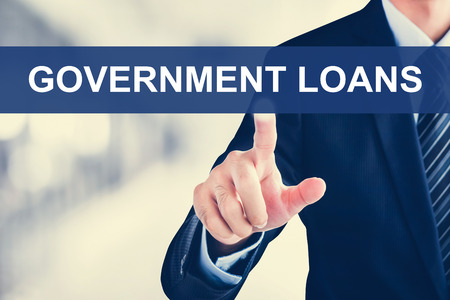 loans: Businessman hand touching GOVERNMENT LOANS message on virtual screen