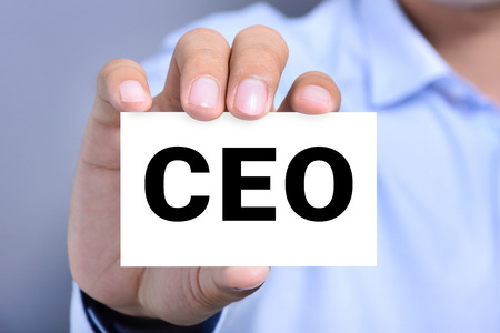 chief executive officer: CEO letters (or Chief Executive Officer) on the card held by a man hand Stock Photo