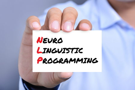 linguistic: Neuro Linguistic Programming (or NLP) message on the card shown by a man
