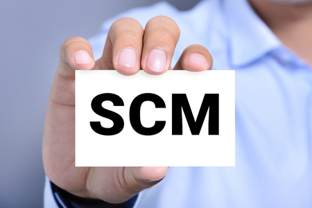 scm: SCM (or Supply Chain Management) letter on the card shown by a man