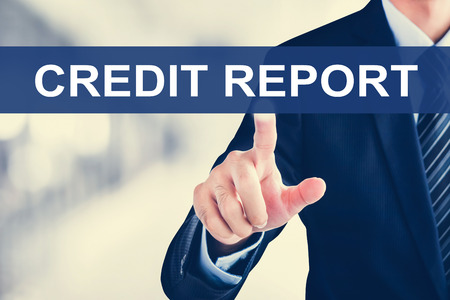 creditworthiness: Businessman hand touching CREDIT REPORT sign on virtual screen