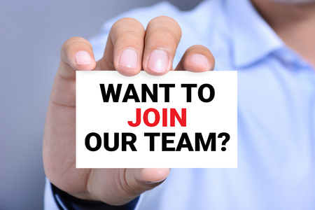 our company: WANT TO JOIN OUR TEAM? message on the card shown by a man
