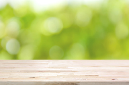 Wood table top on bokeh abstract green background  - can be used for montage or display your products Imagens