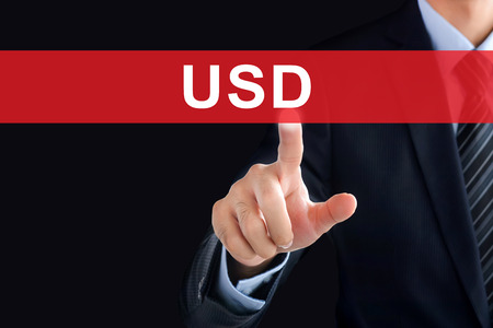 usd: Businessman hand touching USD  (United States Dollar currency code) tab on virtual screen