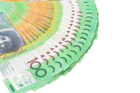 australian dollar notes: Money, one hundred Australian dollar (AUD) banknotes, spread out on white background Stock Photo