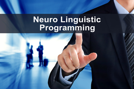 linguistic: Businessman hand touching  Neuro Linguistic Programming (or NLP) message virtual screen