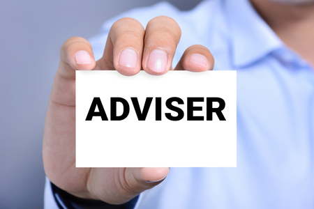 business advisor: ADVISER word on the card held by a man hand Stock Photo