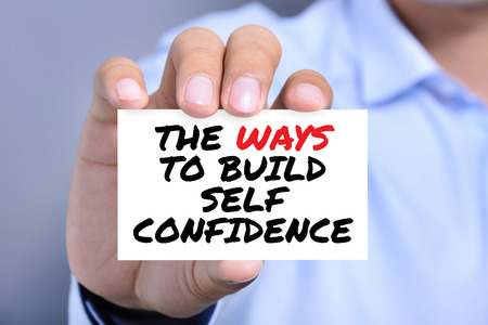 Self Confidence: THE WAYS TO BUILD SELF CONFIDENCE, message on the card shown by a man