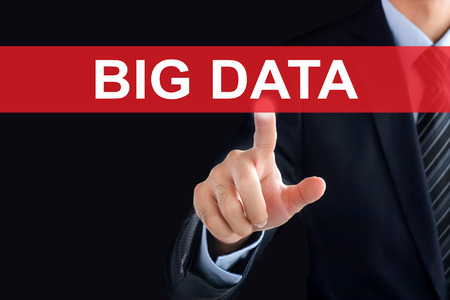 information point: Businessman hand touching BIG DATA sign on virtual screen Stock Photo