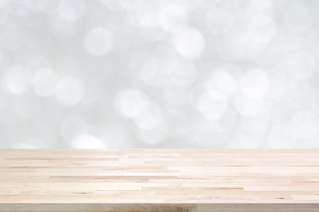 Wood table top on white bokeh abstract background - can be used for montage or display your products 스톡 콘텐츠