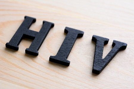 immunodeficiency: HIV (or Human Immunodeficiency Virus) letters on wood background
