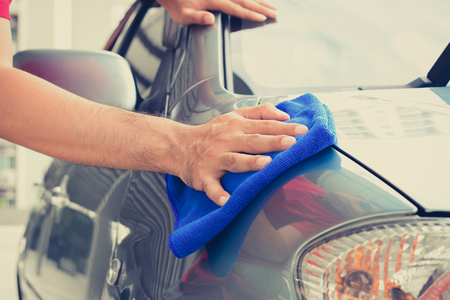 hand rubbing: A man hand cleaning car with microfiber cloth