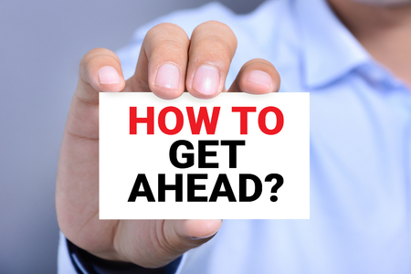 get help: HOW TO GET AHEAD?, message on the card hold by a man hand