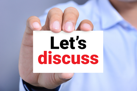 talk show: Lets discuss, message on the card shown by a man Stock Photo