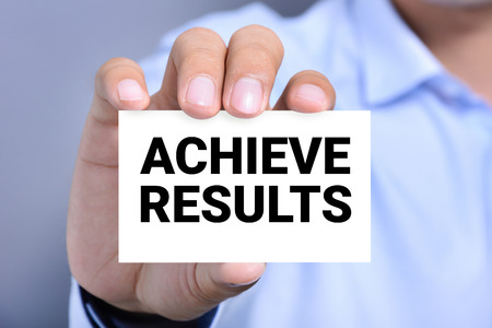 achieve: ACHIEVE RESULTS, message o the card shown by a man