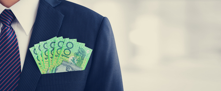 australian money: Money,Australian dollar (AUD) banknotes, in businessman suit pocket - financial and investment panoramic background with copy space