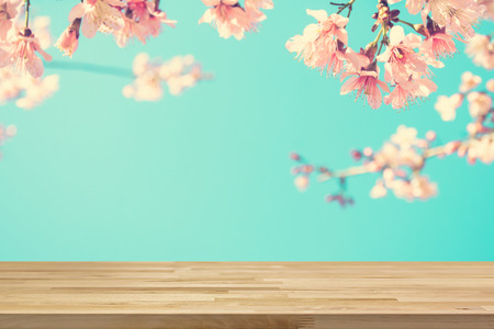 colorful light display: Wood table top on blur pink Sakura flower background, vintage tone - can be used for display or montage your products Stock Photo