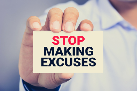 card making: STOP MAKING EXCUSES, message on the card shown by a man