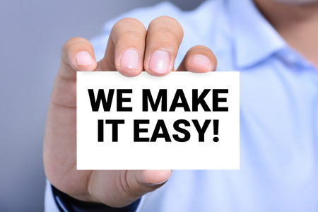 WE MAKE IT EASY! message on the card shown by a man Banque d'images