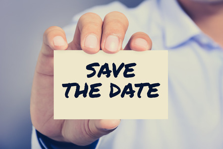 important date: SAVE THE DATE message on the card shown by a man, vintage tone Stock Photo