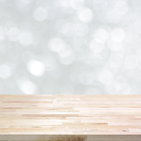 Wood table top on white bokeh abstract background, festive background concept  - can be used for montage or display your products