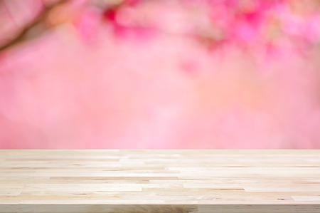 cherry blossom: Wood table top on blurred background of pink cherry blossom flowers - can used for display or montage your products