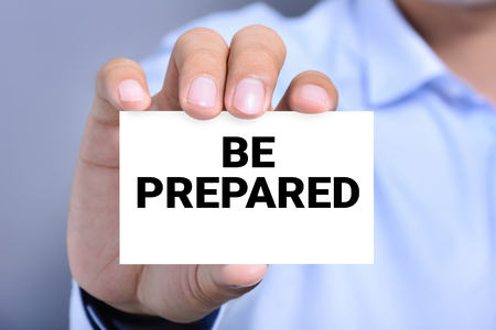 shown: BE PREPARED, message on business card shown by a man Stock Photo