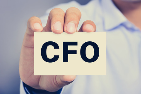 chief executive officers: CFO letters (or Chief Financial Officer) on the card held by a man hand, vintage tone Stock Photo