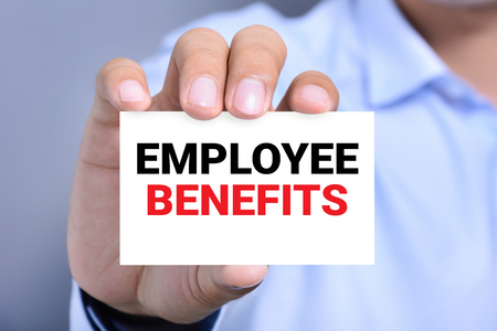 care allowance: EMPLOYEE BENEFITS, message on business card shown by a man Stock Photo