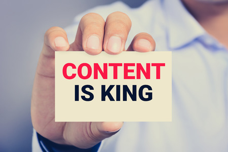 news values: CONTENT IS KING message on the card shown by a man, vintage tone