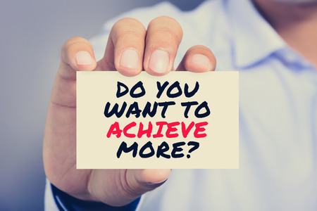 achieve: DO YOU WANT TO ACHIEVE MORE ? message on the card shown by a man, vintage tone