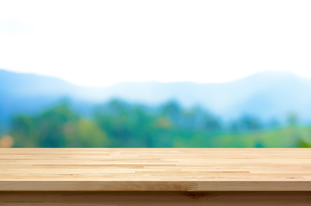 forest products: Wood table top on blur mountain background - can be used for display or montage your products Stock Photo