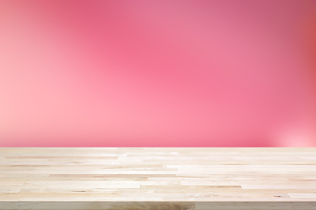 Wood table top on gradient abstract pink background - can be used for display or montage your products