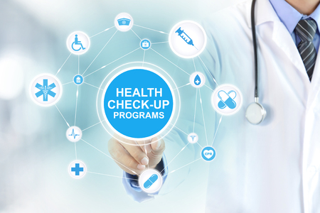 checkup: Doctor hand touching HEALTH CHECK-UP PROGRAMS sign on virtual screen Stock Photo