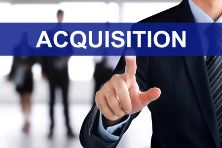 acquiring: Businessman hand touching ACQUISITIONS sign on virtual screen Stock Photo