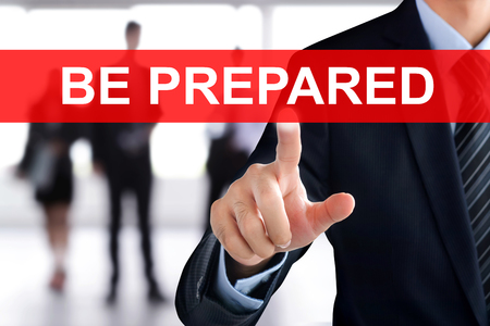 be prepared: Businessman hand touching BE PREPARED tab on virtual screen