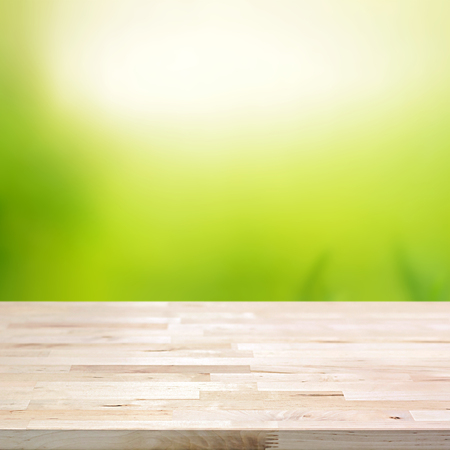 table wood: Wood table top on gradient abstract green background  - can be used for montage or display your products Stock Photo