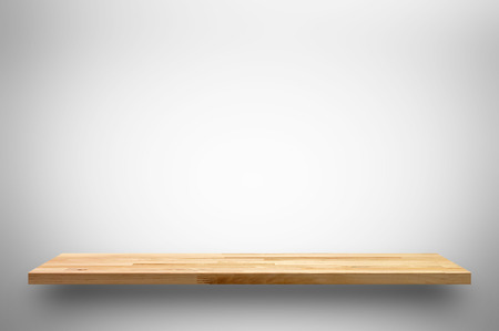 Wooden shelf on white gray gradient background