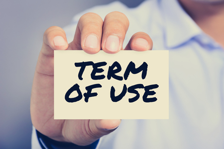 user: TERM OF USE, message on the card shown by a man, vintage tone Stock Photo