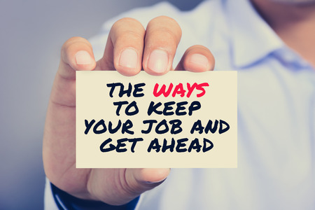keep your hands: THE WAYS TO KEEP YOUR JOB AND GET AHEAD, message on card shown by a man, vintage tone