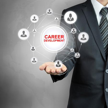 people development: CAREER DEVELOPMENT message with people icon network on businessman hand