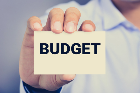 shown: BUDGET word on the card shown by a man