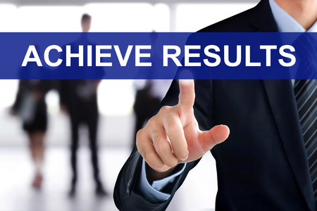 achieve: Businessman hand touching ACHIEVE RESULTS sign on virtual screen